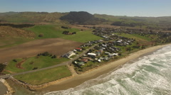 Aerial of coastal town and sea Stock Footage