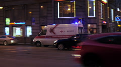 In the evening on a busy road passing ambulance Stock Footage