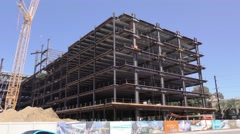 Building under construction on buys street steel workers. Stock Footage