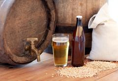 Close up of beer barrel, glass, bottle and malt Stock Photos