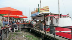 Traditional snack bar on warnow river at harbor of warnemuende Stock Footage