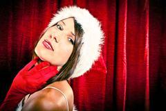 Beautiful sexy christmas santa girl close gaze on red background Stock Photos