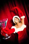 Sexy red santa girl dance with cup at  christmas party Kuvituskuvat