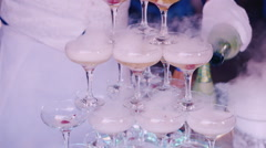 Pour the steaming drink in glasses on a children's party Stock Footage