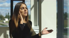 Beautiful brunette businesswoman arguing on the phone Stock Footage
