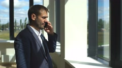 Serious businessman arguing on the phone in the office Stock Footage