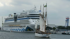 Aida mar cruise ship in harbor of Warnemuende during Hanse Sail event. Stock Footage