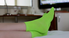 Female legs in pink stockings on bed Stock Footage