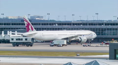 Qatar Airways Boeing 777 at Airport Gate in Washington DC Stock Footage