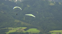 Green hang glider and green paraglider Stock Footage
