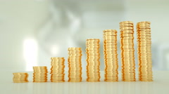 Gold coins stacking up in a column chart style. White background. Stock Footage