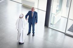 Manager of company receive Arabian partner Stock Photos