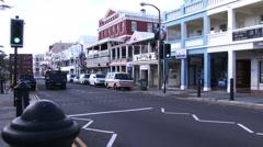 Establishing shot of main street in Hamilton, Bermuda Stock Footage
