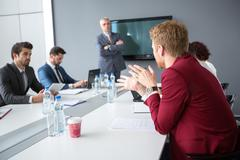Employ present his opinions to director and collogues Stock Photos