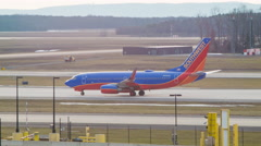 Old Southwest Airlines Boeing 737 Taxiing at Dulles Airport Stock Footage
