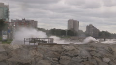 Big waves crash into shore in typhoon and hurricane force wind storm Stock Footage
