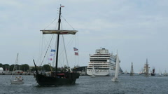 Historical sailing boats and schooner sailing along the Rostock Harbor Stock Footage