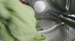Washing machine washes clothes. Stock Footage