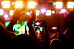 People makes photo with His smartphone on concerts Kuvituskuvat