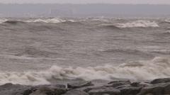 Huge powerful waves breaking at seawall in major severe storm Stock Footage