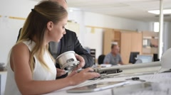 Student with engineer in designer's office Stock Footage