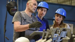 Young people in metallurgy training class Stock Footage
