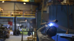 Metalworker welding in manufacture plant Stock Footage
