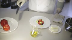 Chef prepares a Greek salad in the kitchen Stock Footage