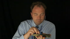 Greedy Doctor Listening To His Money With Stethoscope Stock Footage