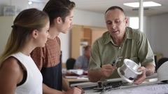 Young people in engineering training class Stock Footage