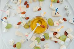 Delicious canapes with honey as event dish Stock Photos