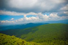 Summer landscape in mountains and the dark blue sky with clouds Stock Photos