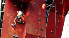 Little girl climbing the rock wall - 4K Stock Footage