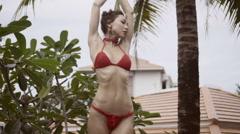 Beautiful brunette woman in crochet bikini Stock Footage