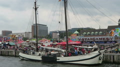People visiting fun fair at Rostock Harbor during Hanse Sail weekend. Stock Footage