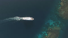 Aerial view of boat, passes through to coral reef lagoon - Shaab Rumi Stock Footage