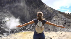 Happy female tourist stand on Sibayak volcano Stock Footage