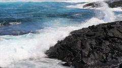 Punaluu beach waves breaking on black lava rock medium shot Stock Footage