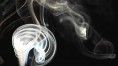 Close-up of incense smoke rising against a black background. Stock Footage