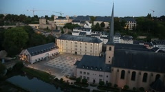 Establishing shot of Neumünster Abbey in the Old Luxembourg City Stock Footage