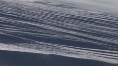 Panning-shot of blowing snow on a slope. Stock Footage