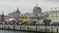 Historical fun fair at the Rostock Harbor at during Hanse Sail weekend event. Stock Footage