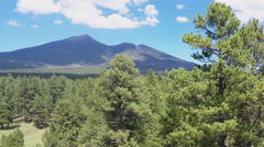 Rising Over Coconino National Forest To Reveal Humphreys Peak Stock Footage