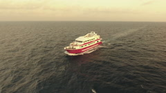 Aerial view of yacht or boat cruising at open sea in sunset Stock Footage