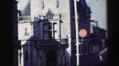 1952: a town with an antique building holding a clock in a tower EDINBOURGH, Stock Footage