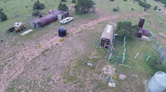 Aerial Fly-Over Of Abandoned Survivalist Bunker Cabin Ranch- Fast Stock Footage