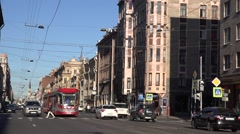 Back-to-back coupled 2-car tram runs along Sredniy Prospect at route 6 Stock Footage