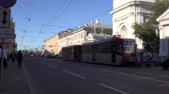Back-to-back coupled 2-car double-sided trams in traffic at temporary terminus Stock Footage