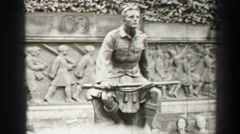 1952: people sit behind statue EDINBOURGH, SCOTLAND Stock Footage