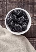 Blackberry in white bowl  on grunge wooden board. Natural healthy food.Still Stock Photos